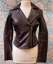 Sale 8577 - Lot 107 - A John Cavill brown leather biker style Jacket, size 10, Condition: very good minor signs of wear