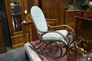 Sale 8050B - Lot 2 - Beech bentwood rocking armchair, upholstered in blue gingham fabric