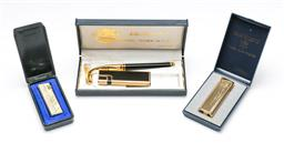 Sale 9164 - Lot 512 - Three cased vintage lighters to include Japanese examples