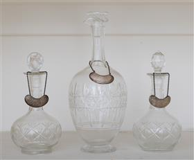 Sale 9195H - Lot 35 - A set of three decanters with silver bottle tickets