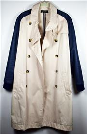 Sale 8460F - Lot 73 - A Sophie Hulme cream trench coat with navy leather sleeves and faux tortoiseshell buttons, size 8