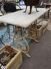 Sale 8740 - Lot 1221 - Marble Top Table on Sewing Machine Base