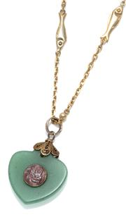 Sale 9037 - Lot 349 - A 9CT GOLD NEPHRITE PENDANT NECKLACE; anchor and fish link chain with bolt ring clasp attached with an heart shape 17.8 x 16.4mm nep...