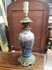 Sale 9031 - Lot 1017 - 19th Century French Chinoiserie Porcelain Oil Lamp, converted to electricity, with blue & white landscape heightened in red & brass...