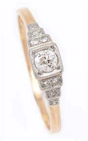 Sale 9044J - Lot 55 - An  18ct gold and platinum ring, the centre diamond framed by a further 3 diamonds to each shoulder