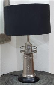 Sale 9066H - Lot 55 - An occasional lamp in the form of a lighthouse with a black timber base and linen shade. Total height 66cm