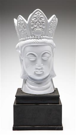 Sale 9209V - Lot 10 - A Chinese ceramic Guanyin head on timber stand (H:50cm)