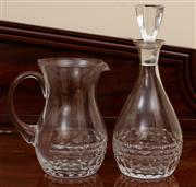 Sale 8882H - Lot 11 - A cut glass decanter and a matching jug (crack to handle), Height of decanter 30cm