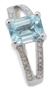 Sale 9066 - Lot 396 - AN 18CT WHITE GOLD AQUAMARINE AND DIAMOND RING; centring on an emerald cut aquamarine of approx. 2.30ct to upswept split shoulders a...