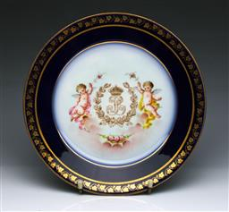 Sale 9093P - Lot 73 - Sevres Style Cherub Plate with Chateau Marks and Louis Philippe Monogram, dia. 23.5cm.
