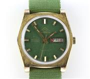 Sale 8644W - Lot 23 - MONDAINE AUTOMATIC WRISTWATCH; green dial, applied markers, center seconds, day date, 25 jewell ETA 2788 movement, stainless steel s...