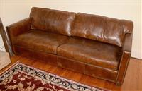 Sale 8171A - Lot 64 - A three seater distressed brown leather sofa with chrome stud details, H 100, W 220, D 98cm