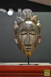 Sale 8515 - Lot 1011 - Urhobo Tribal Nigerian Mask on Stand