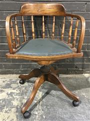 Sale 8976 - Lot 1029 - Early 20th Century American Walnut & Beech Desk Chair, with spindle gallery & green padded seat (repair to seat, upholstery slightly...