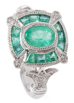 Sale 9132 - Lot 417 - AN ART DECO STYLE EMERALD AND DIAMOND RING; set in 9ct white gold with a central oval cut emerald to surround of mixed cut emeralds...