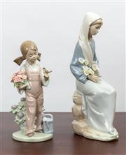 Sale 8774A - Lot 180 - Two Lladro figurines, one in dungarees gardening and the other with lillies Taller 24cm