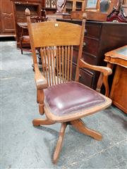 Sale 8848 - Lot 1069 - American Oak Desk Armchair, with spindle back & burgundy leather seat, Croker Chair Company