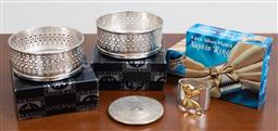 Sale 9140H - Lot 25 - A pair of Strachan silver plated bottle coasters together with silver plated napkin rings