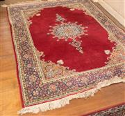 Sale 8368A - Lot 12 - A graduating pair of Persian rugs with central medallion on red ground with foliate border, larger 125 x 185cm
