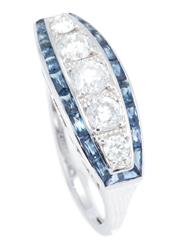 Sale 8937 - Lot 370 - A DECO STYLE HALF HOOP SAPPHIRE AND DIAMOND RING; centring 5 round brilliant cut diamonds totalling approx. 0.80ct within a surround...