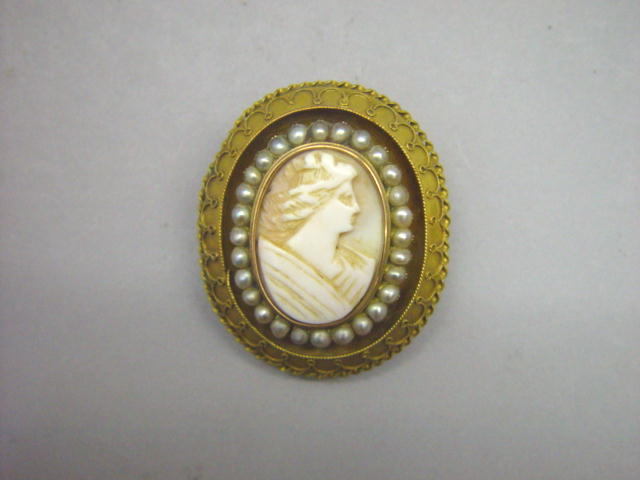 Sale 3545 - Lot 24 - A CAMEO LOCKET BROOCH;