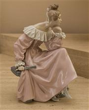 Sale 8313A - Lot 22 - A Lladro figurine of a lady with a fan reading a book, F-23 E, height 30cm