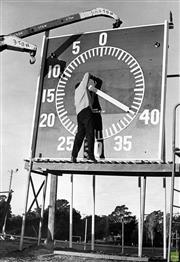 Sale 8721A - Lot 44 - Artist Unknown - Clock being installed at Sutherland Oval, 1967 30 x 20cm