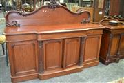 Sale 8093 - Lot 1701 - Late 19th Century Cedar Breakfront Sideboard, the shaped back decorated with carved fruit (key in office)