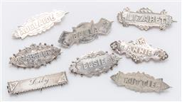 Sale 9180E - Lot 92 - A group of eight sterling silver name pins, total weight 20g, average length 4.5cm