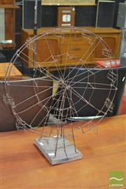 Sale 8275 - Lot 1069 - A Wire Work Ferris Wheel on Timber Base (height 60cm)