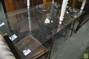 Sale 8383 - Lot 1087 - A Stylised Cast Iron Based Outdoor Table with Glass Top (152 x 92cm)