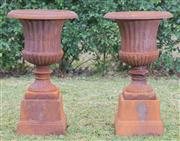 Sale 8422A - Lot 13 - A pair of cast iron urns (two pieces), height 67cm