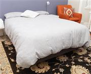 Sale 8863H - Lot 61 - A double bed frame and mattress with grey bed linen