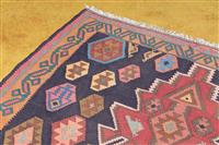 Sale 8934H - Lot 45 - A kilim in reds with birds, fish and people on a blue ground, 365cm x 170cm