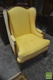 Sale 8335 - Lot 1018 - French Style Carved Beech Wingback Armchair, upholstered in yellow fabric & on cabriole legs