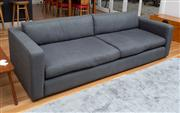 Sale 8741A - Lot 59 - A charcoal four seater Arther G sofa Height of back 63cm, L x 256cm, D x 104cm