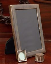 Sale 8882H - Lot 33 - A modern sterling silver photo frame (some dents), together with smaller frame and Mexican sterling pillbox, Height 22cm