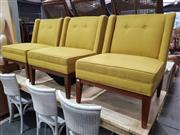 Sale 8934 - Lot 1046 - Set of Three Modern Lounge Chairs in Mustard Fabric