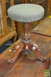 Sale 8267 - Lot 1069 - Victorian Walnut Piano Stool, with round green adjustable seat, on carved pedestal with legs