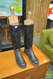 Sale 8275 - Lot 1090 - A pair of vintage black leather riding boots with timber stocks