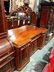Sale 8693 - Lot 1097 - Victorian Mahogany Breakfront Sideboard, with carved mirror back above a drawer and 2 small panel doors, flanked by a larger pair of...