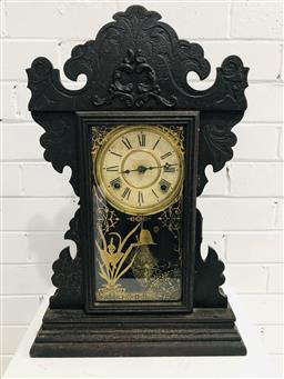 Sale 9097 - Lot 1035 - Late 19th Century American Mantle Clock by Welch, with typical pressed decoration & gilt stencil on glass panel door, 58 x 38cm