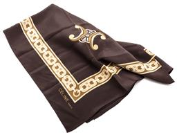 Sale 9132 - Lot 406 - A CELINE SILK SCARF; beige, cream and olive fancy link border, with four medallions to the corners on a dark brown background, machi...