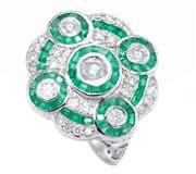Sale 8937 - Lot 440 - AN EMERALD AND DIAMOND RING; quatrefoil form set with four clusters each centring a round brilliant cut diamond to tapered square cu...