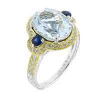 Sale 8221A - Lot 112 - 18ct White Gold Aquamarine and Sapphire Diamond Ring; centering an oval cut aquamarine estimated 3.92ct, adjacent to two blue sapphi...