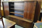Sale 8532 - Lot 1193 - Art Deco German Bookcase with Veneered Rosewood Panels and Drawers to Base (2 x Keys in Office) - H 165 x W 275 x D 40.5cm