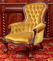 Sale 8804A - Lot 93 - A Victorian carved mahogany balloon back gentlemans armchair in button back gold velvet
