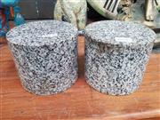 Sale 8925 - Lot 1058 - A pair of granite doorstops of cylindrical form