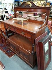Sale 8693 - Lot 1027 - Late Victorian Walnut Dumbwaiter, with mirror back & two drawers, above an open shelf & two carved panel doors