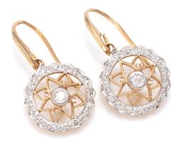 Sale 9221 - Lot 310 - A PAIR OF EDWARDIAN STYLE DIAMOND EARRINGS; cartwheel design each with pierced starburst feature centring a round brilliant cut diam...